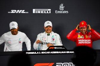 Lewis Hamilton, Mercedes AMG F1, pole man Valtteri Bottas, Mercedes AMG F1, and Sebastian Vettel, Ferrari, in the post Qualifying Press Conference