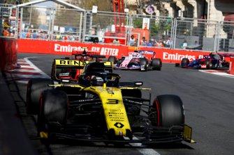 Daniel Ricciardo, Renault R.S.19, leads Charles Leclerc, Ferrari SF90, and Lance Stroll, Racing Point RP19