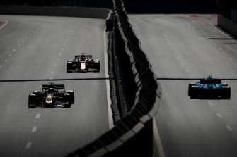 Kevin Magnussen, Haas F1 Team VF-19, leads Max Verstappen, Red Bull Racing RB15