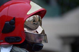 Valtteri Bottas, Mercedes AMG W10, reflected in a fire marshals visor