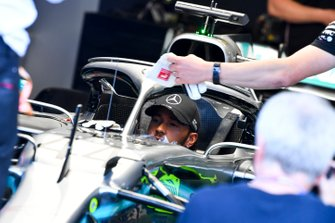 Lewis Hamilton, Mercedes AMG F1 W10 sits in the cockpit of his car in the garage