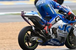 Alex Rins, Team Suzuki MotoGP realising there is a strap attached to his bike