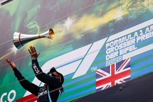 Lewis Hamilton, Mercedes-AMG F1, throws trophy up in the air