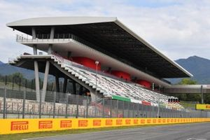 The pit straight grandstand and Pirelli branding