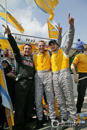 Marcel Tiemann and Timo Scheider celebrate with Opel mechanics after their race win