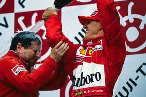 Michael Schumacher, 1st position, pours Champagne over Jean Todt, Team Principal, Ferrari, on the podium after securing the world championship