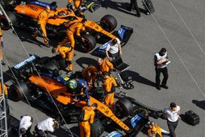 Lando Norris, McLaren, and Carlos Sainz Jr., McLaren, on the grid