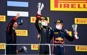 Christian Lundgaard, ART Grand Prix, 1st position, and Juri Vips, Dams, 3rd position, on the podium with their trophies