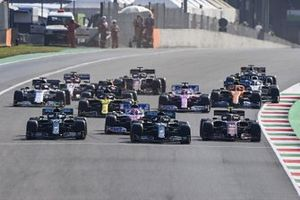 Lewis Hamilton, Mercedes F1 W11, Valtteri Bottas, Mercedes F1 W11, Lance Stroll, Racing Point RP20 and Charles Leclerc, Ferrari SF1000 battle at the restart