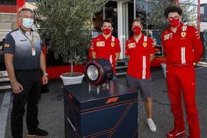 Mario Isola, Racing Manager, Pirelli Motorsport with Charles Leclerc, Ferrari, Sebastian Vettel, Ferrari, and Mattia Binotto, Team Principal Ferrari with the Pirelli Pole Position Award for Ferrari's 1000th race