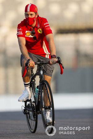 Sebastian Vettel, Ferrari walks the track on a bike