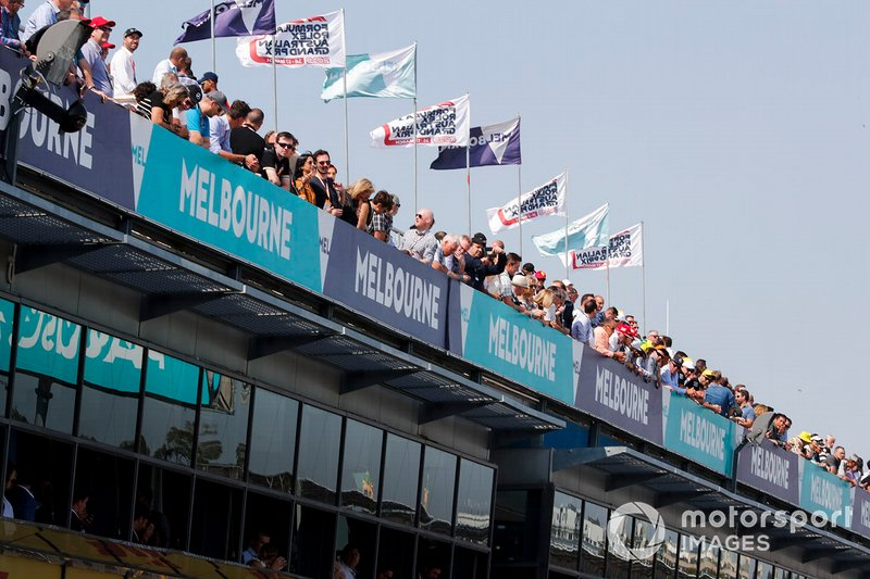 Fans watch fro above the pits