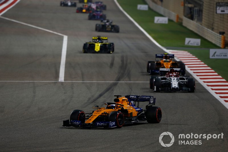 Carlos Sainz Jr., McLaren MCL34, leads Kimi Raikkonen, Alfa Romeo Racing C38, Lando Norris, McLaren MCL34, and Daniel Ricciardo, Renault R.S.19