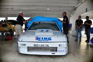 Jim Dentici and Herbert Gomez unveil the restored 1988 Acura Integra