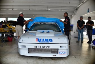 Jim Dentici and Herbert Gomez unveil the restored 1988 Acura Integra