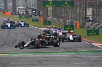 Romain Grosjean, Haas F1 Team VF-19, leads Kevin Magnussen, Haas F1 Team VF-19 Kimi Raikkonen, Alfa Romeo Racing C38, Lance Stroll, Racing Point RP19, Antonio Giovinazzi, Alfa Romeo Racing C38, and the remainder of the field on the opening lap