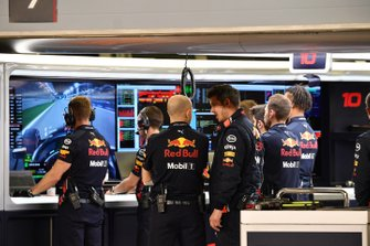 Red Bull team personnel watch the monitors during Qualifying