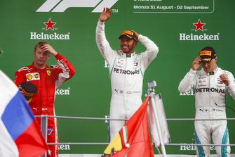 Kimi Raikkonen, Ferrari, second position, Lewis Hamilton, Mercedes AMG F1, first position, and Valtteri Bottas, Mercedes AMG F1, third position, celebrate on the podium