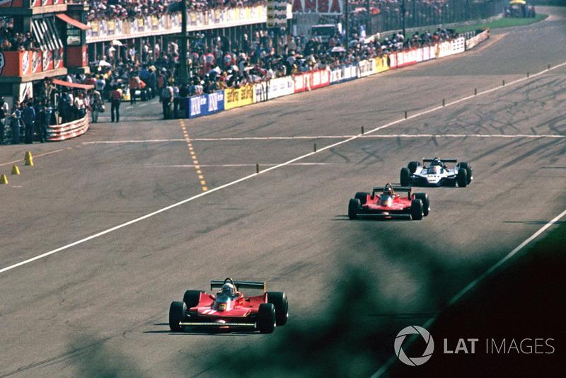 Jody Scheckter, Ferrari 312T4 leads Gilles Villeneuve, Ferrari 312T4B and Jacques Laffite, Ligier JS11