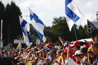 Finnish flags among a crowd of fans