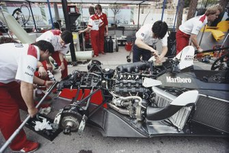 Mechanics work on the McLaren MP4-4 Honda of Alain Prost