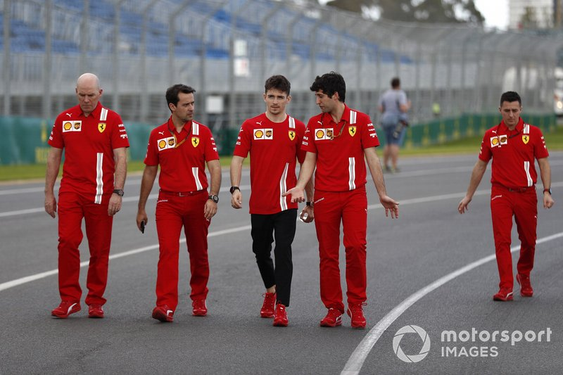 Charles Leclerc, Ferrari walks the track with members of his team including Jock Clear, Race Engineer, Ferrari