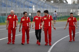 Charles Leclerc, Ferrari walks the track with members of his team including Jock Clear, Race Engineer, Ferrari