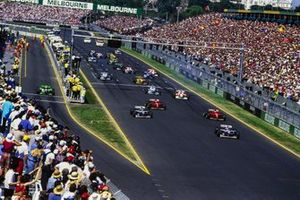 Start action, Jacques Villeneuve, Williams FW18 Renault, leads Damon Hill, Williams FW18 Renault, Eddie Irvine, Ferrari F310, and Michael Schumacher, Ferrari F310