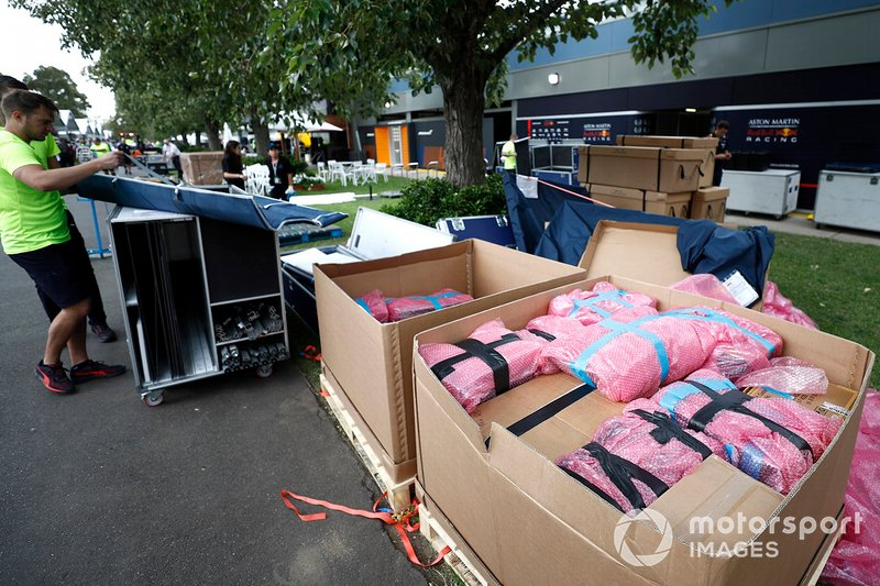 Red Bull personnel pack away their equipment in the paddock