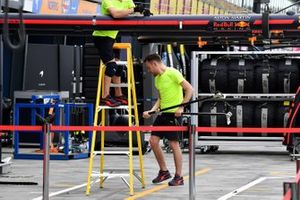 Red Bull personnel pack away in the pitlane