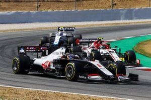 Romain Grosjean, Haas VF-20, leads Antonio Giovinazzi, Alfa Romeo Racing C39, and Nicholas Latifi, Williams FW43