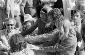 Race winner Jochen Rindt celebrates on the victory lap