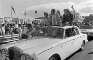 Race winner Jochen Rindt on the victory lap with Chris Amon, 2nd position, and Jack Brabham, 3rd position
