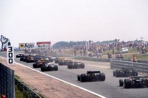 The field heads towards the first corner at the start of the race