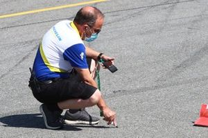 Michelin tyre technician taking track temperature