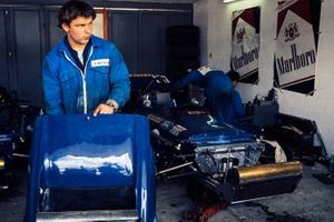 Mechanics work on the March 701 Ford in the garage