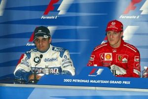 Pole sitter Michael Schumacher, Ferrari, second place Juan Pablo Montoya, Williams