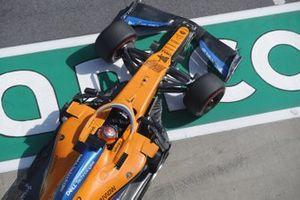 Carlos Sainz Jr., McLaren MCL35, leaves the garage