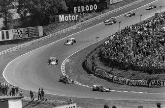 Jacky Ickx, Ferrari 312B2, Emerson Fittipaldi, Lotus 72D Ford y Jean-Pierre Beltoise, BRM P160C