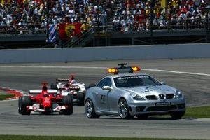 The safety car leads Michael Schumacher, Ferrari F2004