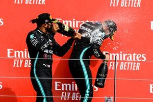 Lewis Hamilton, Mercedes-AMG Petronas F1, 2nd position, sprays Champagne at Valtteri Bottas, Mercedes-AMG Petronas F1, 3rd position, on the podium