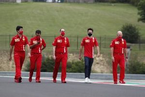 Charles Leclerc, Ferrari, walks the track with colleagues including Jock Clear