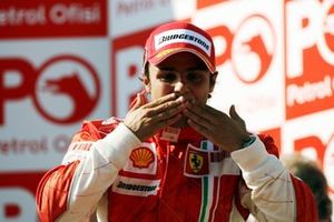 Race winner Felipe Massa, Ferrari celebrates on the podium