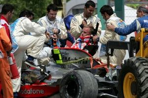 Heikki Kovalainen, Mclaren MP4-23 crashes into the tyre wall and is carried out of the car by the medics