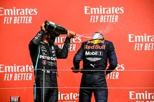 Lewis Hamilton, Mercedes AMG F1 and Race winner Max Verstappen, Red Bull Racing celebrate on the podium with the champagne