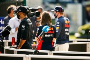 Lewis Hamilton, Mercedes AMG F1, and Max Verstappen, Red Bull Racing, are interviewed after the race