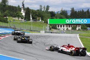 Kevin Magnussen, Haas VF-20, leads Esteban Ocon, Renault F1 Team R.S.20, and Kimi Raikkonen, Alfa Romeo Racing C39