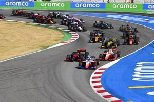 Robert Shwartzman, Prema Racing, leads Callum Ilott, UNI-VIRTUOSI, Mick Schumacher, Prema Racing, Guanyu Zhou, UNI-VIRTUOSI, Felipe Drugovich, MP Motorsport, Jack Aitken, Campos Racing, and the rest of the field at the start