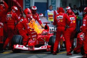 Michael Schumacher, Ferrari F2003-GA catching fire during a pitstop