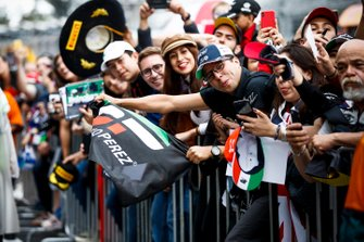 Fan of Sergio Perez, Racing Point waiting with a flag